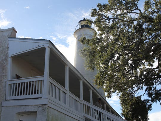 John Roberts descends the stairs of the St. Marks Lighthouse.