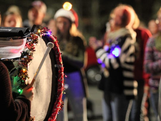 The Owen High School marching band performs a holiday song last year at the intersection of Cherry Street and Sutton Avenue during Holly Jolly, which returns on Friday, Dec. 7.