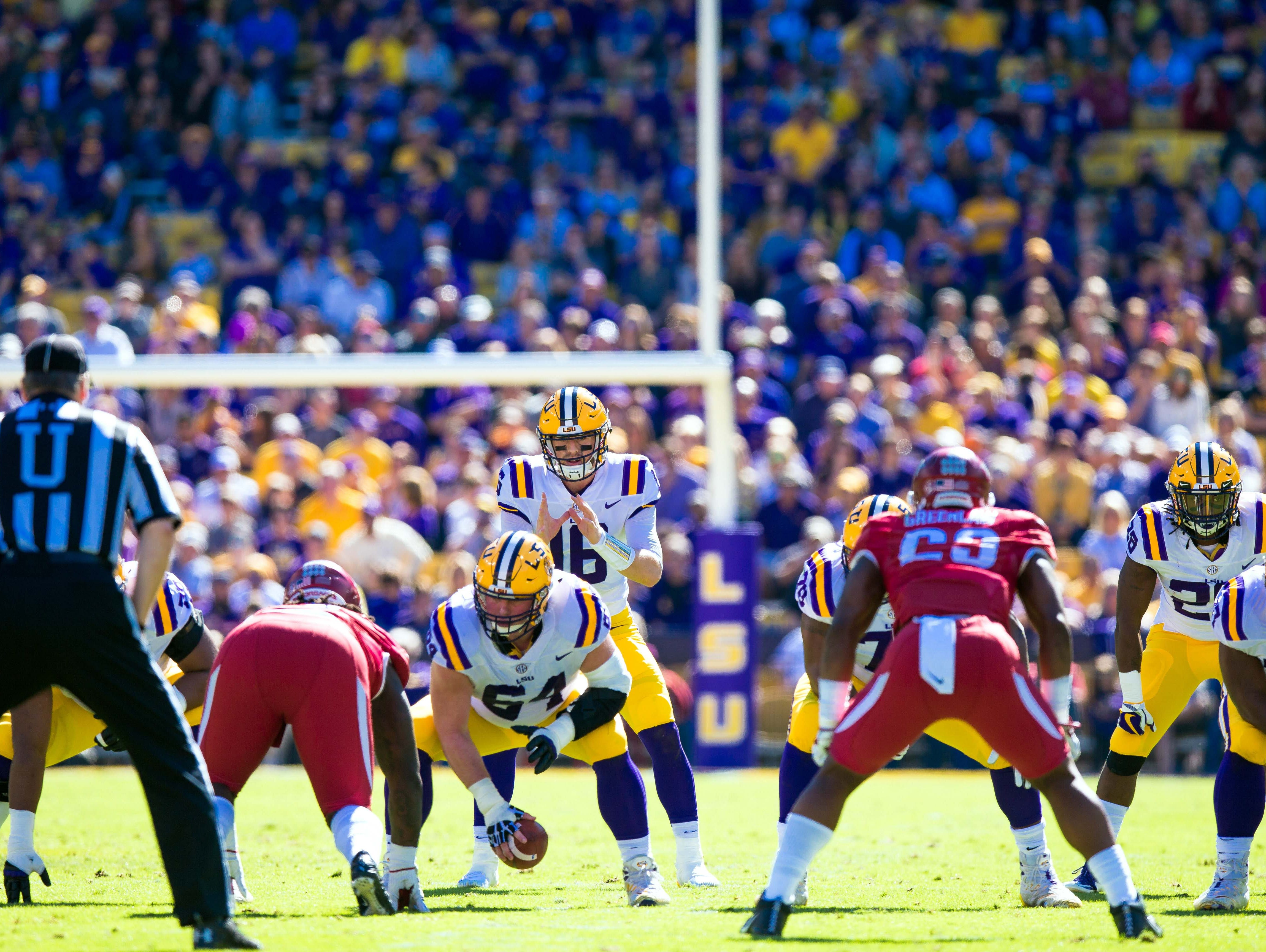 LSU Tigers quarterback Danny Etling (16) calls for the ball from center Will Clapp (64) against Arkansas Razorbacks during the first quarter at Tiger Stadium.