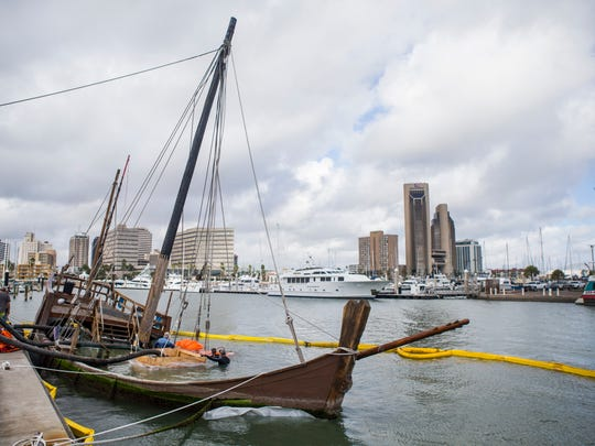 Crews prepare to raise the La Niña from the bottom of the bay Monday, Dec. 4, 2017, at the Lawrence Street T-head. The replica Columbus ship sank when Hurricane Harvey struck Corpus Christi in late August.