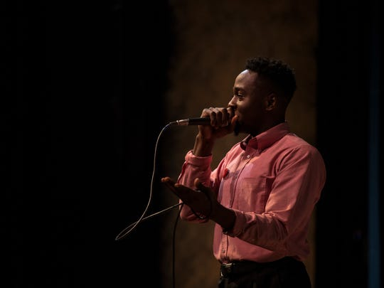 """Emmett Phillips tells his story, """"A performer's choice,"""" during the Des Moines Storytellers Project: New Beginnings event on Dec. 5 at the Des Moines Playhouse."""