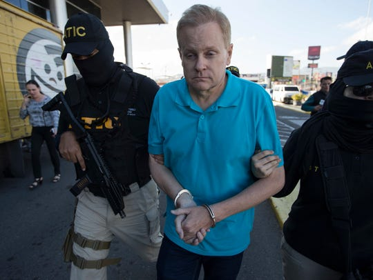 Eric Conn is escorted by SWAT team agents prior to