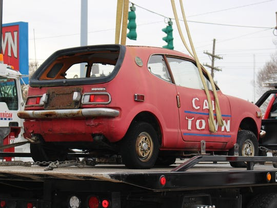 The Car Town elevated car is secured to a trailer as