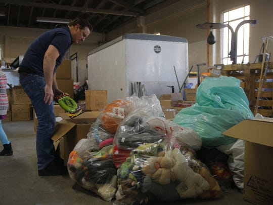 Mike Mizer sifts through toys that will be donated