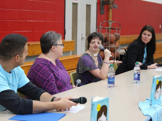 Sarah Freund talks about what life is life living with Treacher Collins syndrome and a facial difference at a recent school-wide assembly at Sabish Middle School in Fond du Lac. From left are Sabish teacher Ryan Trelevan, Sarah's mother Sue Freund, Sarah, and Sabish teacher Wendy Evans.