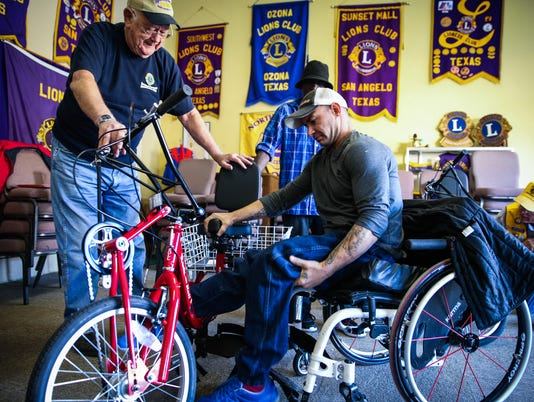 San Angelo Lions Charities distribute tricycles Dec. 9, 2017
