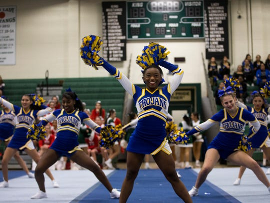 Moody High School's cheer team performs during a mock