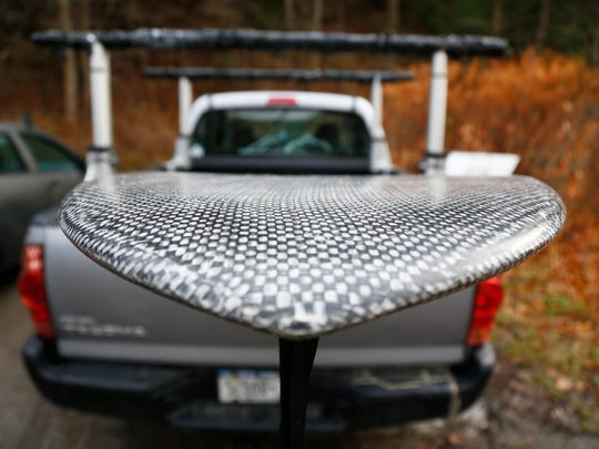 A stand up paddle board owned by Steve Bush sits in his pickup truck before taking to the Chenango River in Chenango Forks on Monday, December 4, 2017.