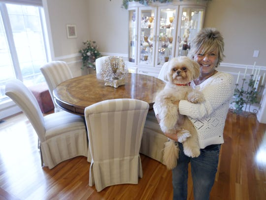 Owner Ann Kolhagen with her dog Nala at her Webster