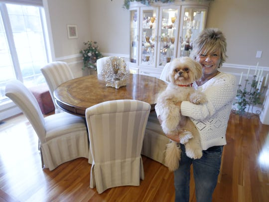 Owner Ann Kolhagen with her dog Nala at her Webster home on Mont Blanc Drive. Ann and her husband Mark are downsizing to a smaller home.