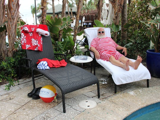 Santa Max takes a break to lay poolside and catch a