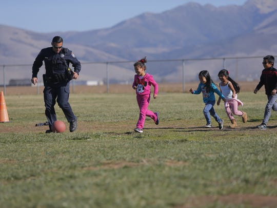 Officer Lino Sanchez participating in activities with