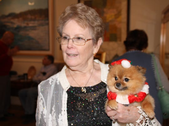 Suzanne Stewart, director of the Deming-Luna-Mimbres Museum, brought a special guest to the annual Green Tea fundraiser.