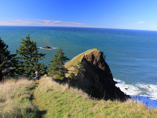 Eric Johnson follows a ridgeline to God's Thumb north of Lincoln City.