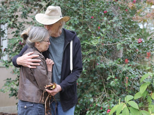 Beth Frederick and Steven Hjelm, in tears, embrace in the garden in front of their Betton Hills home. It was planted in memory of their daughter Jennifer Casey Norred, who was found dead in her jail cell July 24. Her death is believed to be a suicide.