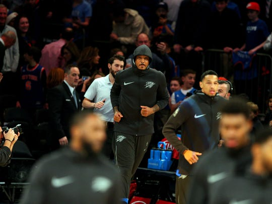 Oklahoma City Thunder power forward Carmelo Anthony (7) runs to the court for warmups before a game against the New York Knicks at Madison Square Garden on Saturday, Dec. 16, 2017, Anthony's first game at MSG since he was traded.