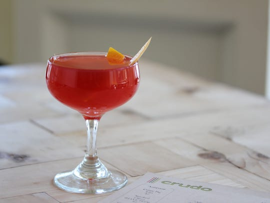 Enjoy a $7 cocktail during happy hour at Crudo.