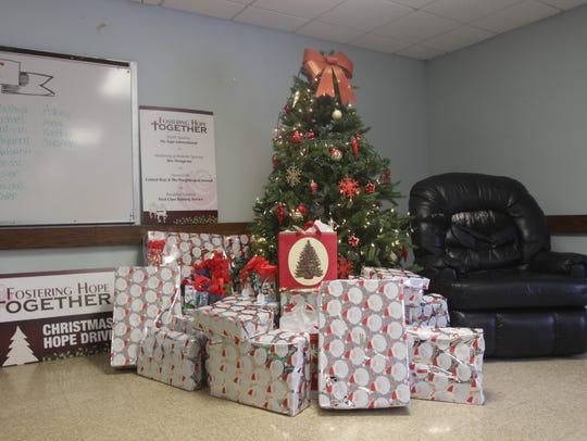 Presents sit under the tree on Sunday morning. Many