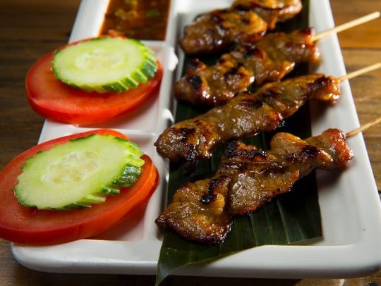 Moo ping, grilled marinated pork skewers,  at  AppeThai,