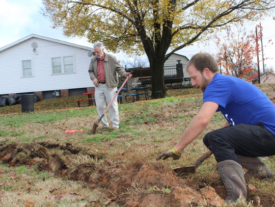 John Ratcliff, left, and John-Paul Young digging trenches