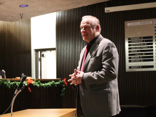 Richland County Juvenile Court Judge Ron Spon speaks to first-ward city councilman Mike Hill on Tuesday, Dec. 19, 2017. Hill is retiring at the end of the year after 22 years on council.