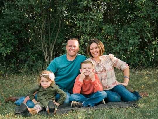 Laura Zylstra Kaiser, far right, poses with her husband Dan Kaiser, an Aberdeen Police Sergeant, and their two children.