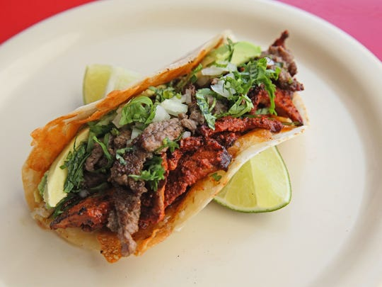 The Laughing Taco's campechano taco combines pork and beef on a flour tortilla griddled with crisp cheese.