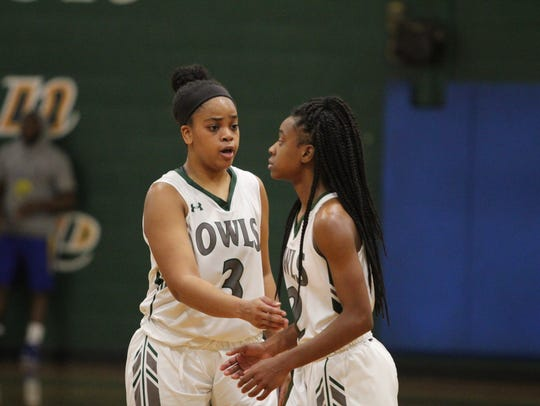 Junior Amber Godfrey, left, the Owls' leading scorer through the first half of the season, talks to freshman guard Tierney Porter between possessions in a Dec. 5 win at home against Mars Hill University.