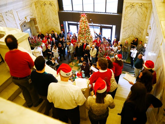 Security Mutual Life staff sing Christmas carols inside