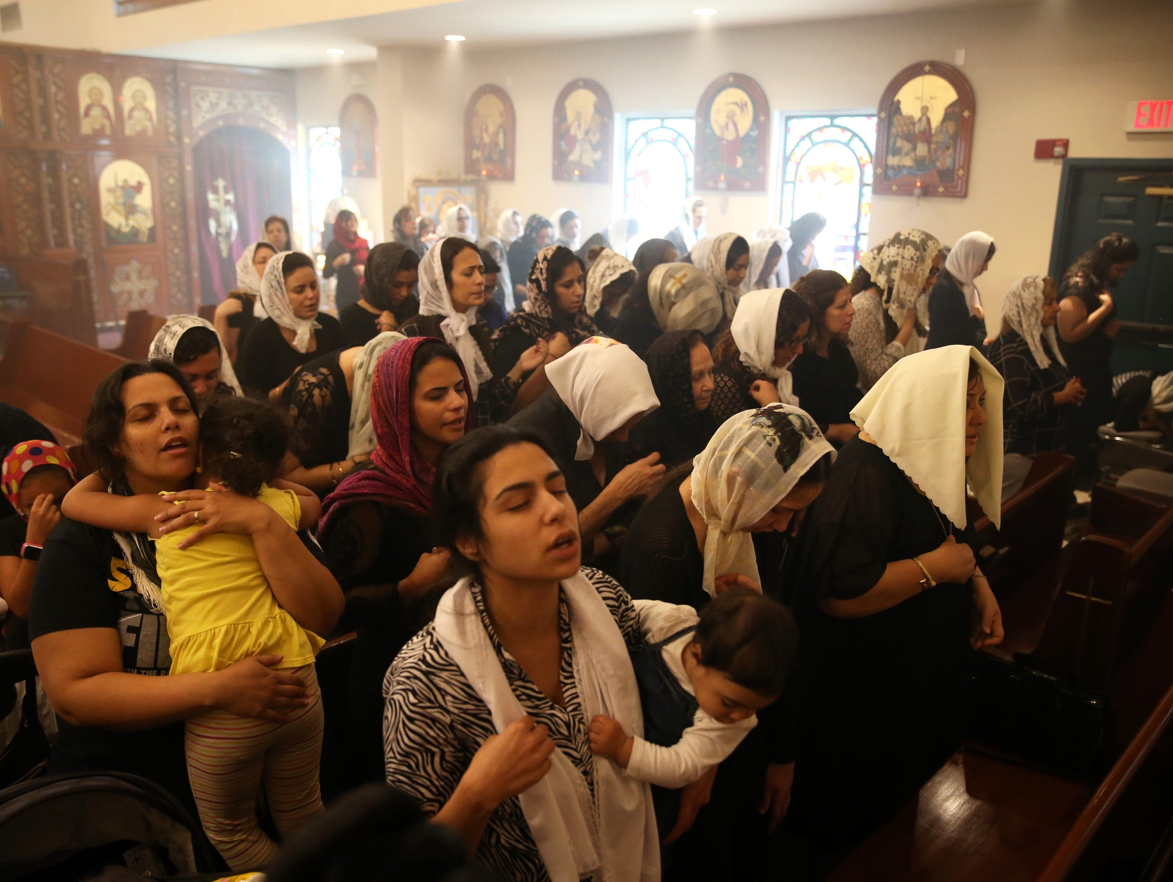 "St. Mary & St. George Coptic Orthodox Church's female parishioners chant 400 hundred times, ""Lord have mercy"" in Coptic, Arabic and English as they observe Good Friday at their church on April 14, 2017."