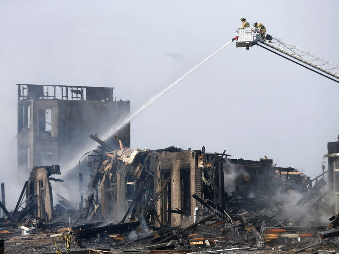 Waukee fire fighters continue to work the scene Saturday,