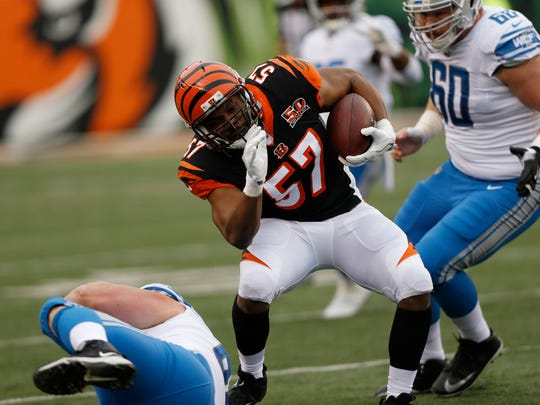 Cincinnati Bengals outside linebacker Vincent Rey (57) runs after intercepting a pass during the first half of an NFL football game against the Detroit Lions, Sunday, Dec. 24, 2017, in Cincinnati.