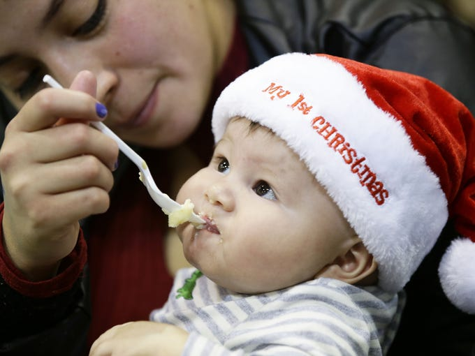 Five-month-old Liam Rico, of Phoenix, enjoys a meal