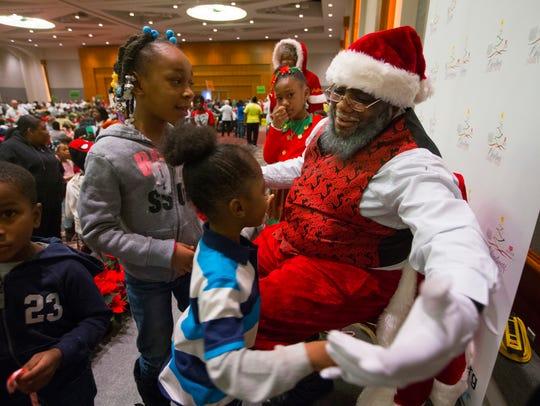 Santa (Robert Boyd) greets children at the 28th annual