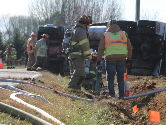 Authorities work to clean up a fuel tanker that overturned near Belton.