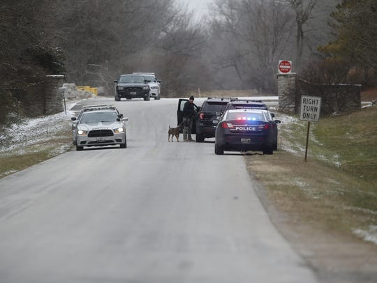 Police search a wooded area near Willard for suspects