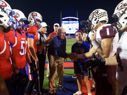 Gregory-Portland former head coach Ray Akins greets players after tossing the coin Friday, Oct. 7, 2016, at Ray Akins Wildcat Stadium in Portland.