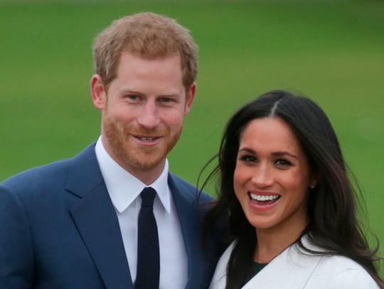 Prince Harry and fiancée Meghan Markle pose in the