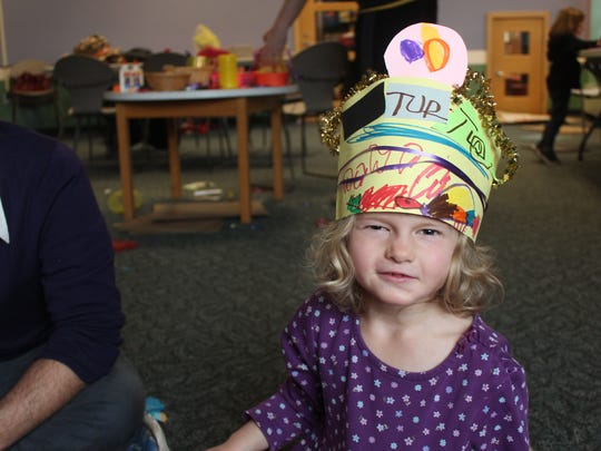 Sylvie Baraddock, 5, poses in the hat she created at