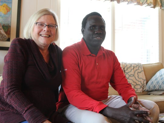 Victor Deng and Patricia Beall spend time together at her Lee Avenue home in December. Deng came to visit Beall, who has been like his mother since he came to the U.S. as a refugee 16 years ago, when she told him of her terminal cancer diagnosis. She sponsored and mentored Deng when he first came to the U.S. 16 years ago as a Sudanese refugee. Since then, she's been like his mother, Deng said.