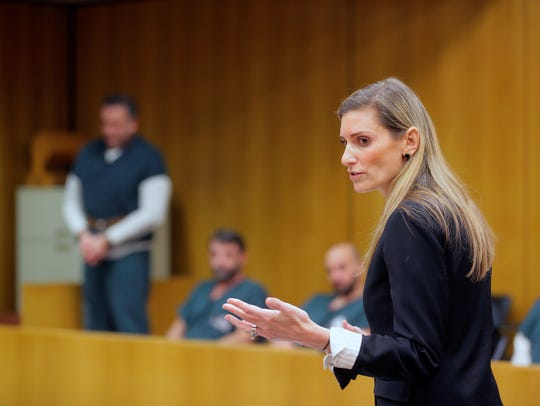 Ocean County assistant prosecutor Jill O' Malley argues