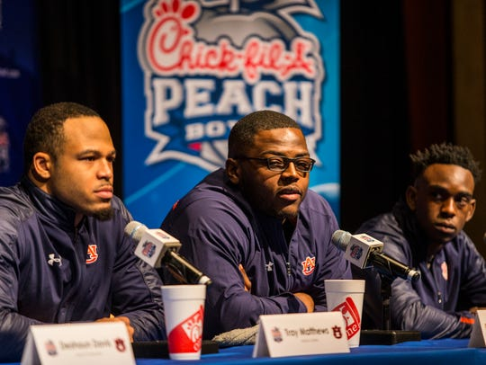 Auburn Tigers players and coaches hold a press conference