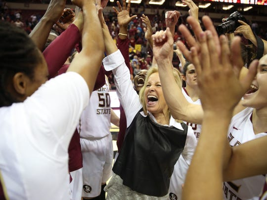 FSU Head Coach Sue Semrau celebrates with her team after their 72-65 win against Louisville at the Tucker Civic Center on Thursday, Jan. 12, 2017.