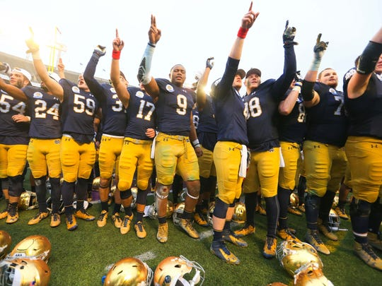 Notre Dame Fighting Irish players celebrate after defeating