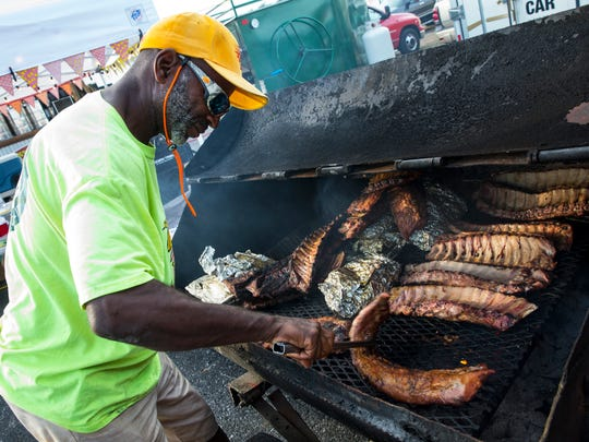Lamarr Marshall, 52, flips ribs during the fifth annual Big Swamp Smoke-Off at the Collier County Fairgrounds in Naples, Florida on Friday, Jan. 6, 2016.