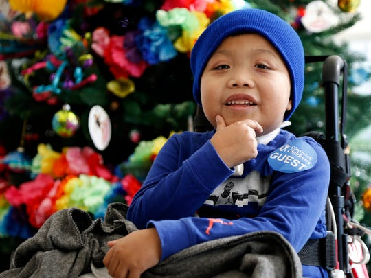 Ricky Solis, 6, smiles as his mother speaks at Cincinnati Children's Hospital Liberty Campus in Liberty Township, Ohio, on Wednesday, Jan. 3, 2018. Solis has been bound to a wheelchair after a drivers crossed lanes and struck Solis and his mother Sandra Mendez in their car.