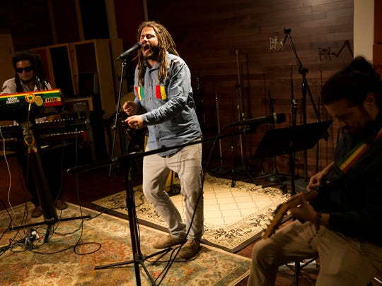 Roots Almighty keyboardist Ras Chul, from left, singer and songwriter Jesus Martinez, and guitarist Willy La Torre, as well as drummer George Cadle and bassist Alonso Wiener (not pictured) perform in their studio Friday, Jan. 5, 2018 in Bonita Springs. The local reggae group would open up for the iconic band The Wailers that night at the SWFL Event Center.