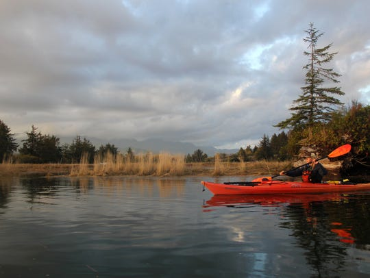 Ginnette Marberry kayaks Bott's Marsh in the Nehalem