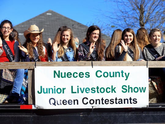 Queen Contestants wave to a crowd during the 81st Annual