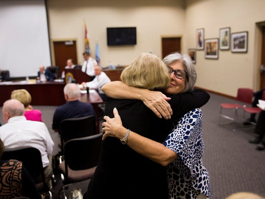 Sharon Young, right, receives a hug from Kathy Katz